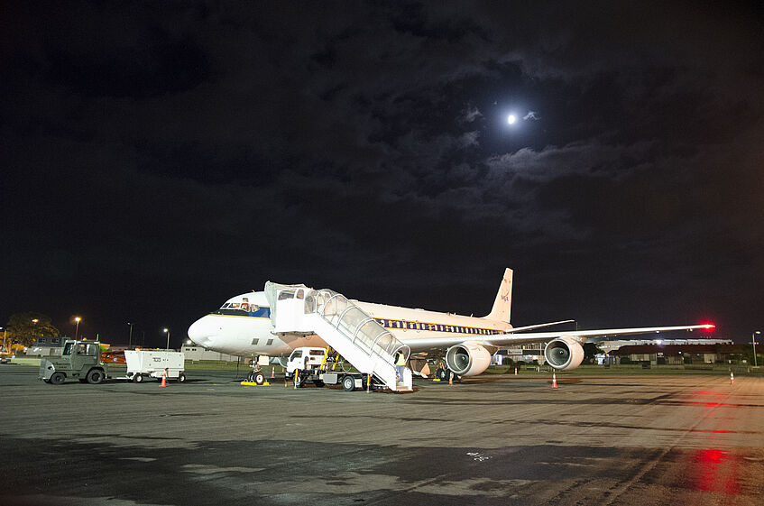 Early take off in Christchurch. The DC-8 with the moon in the background.