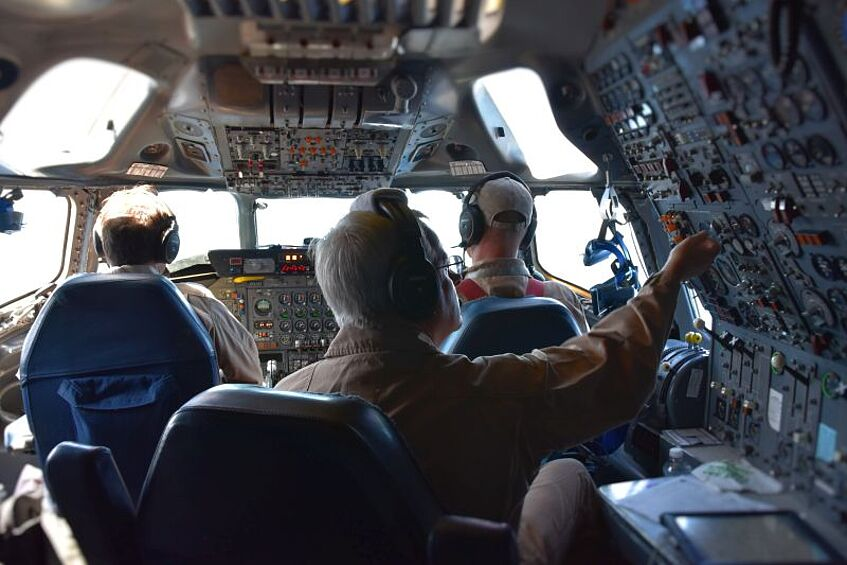 Left: In the cockpit of the DC-8.